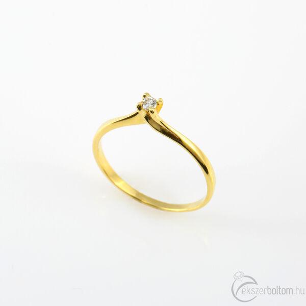 Sárga arany szoliter gyémánt gyűrű csavart karmos foglalattal