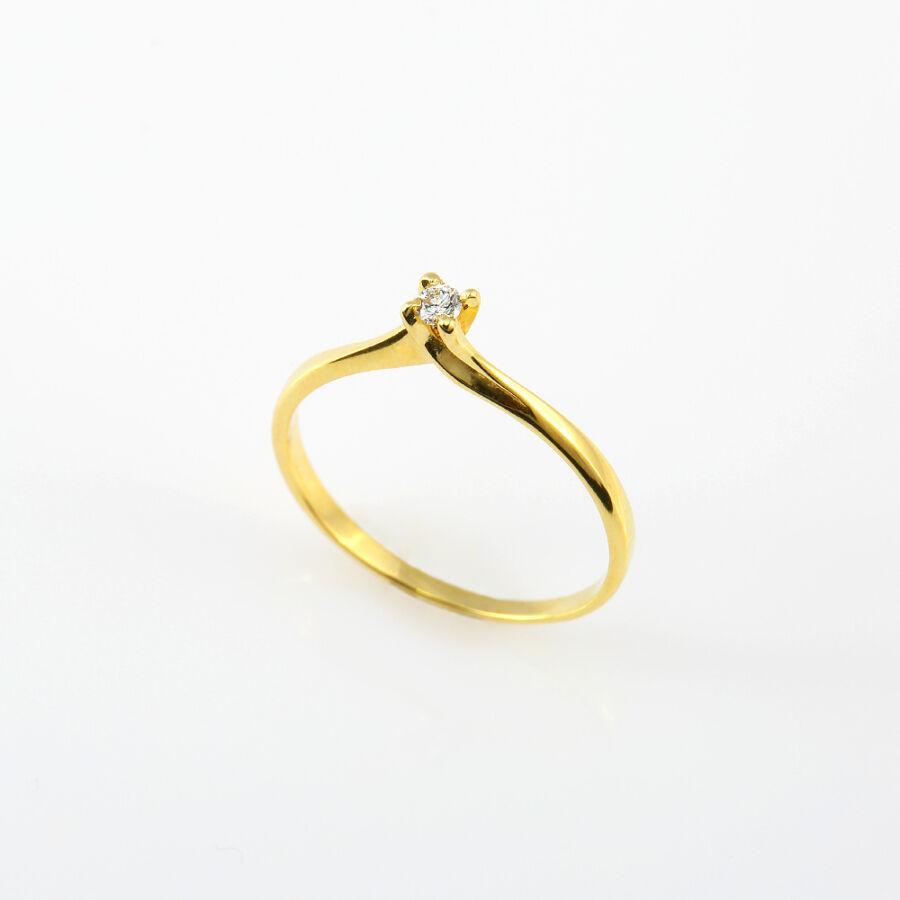 Sárga 14 karátos arany szoliter gyémánt gyűrű csavart négykarmos foglalattal (57-es méret)